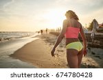 the girl is walking on the... | Shutterstock . vector #674780428