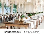 wedding table decorated in the... | Shutterstock . vector #674784244