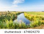 dutch polder landscape during... | Shutterstock . vector #674824270
