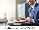 happy man dining in cafe | Shutterstock . vector #674827108