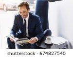 joyful man in suit entertaining ... | Shutterstock . vector #674827540