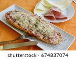 bread pizza with ham and cheese | Shutterstock . vector #674837074