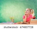 little student thinking in... | Shutterstock . vector #674837728