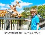 little kid boy watching and... | Shutterstock . vector #674837974