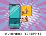 thumb up gesture smartphone.... | Shutterstock . vector #674854468