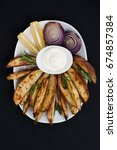 Small photo of Baked potatoes and red lus with rosemary, lemon and aioli sauce on a white plate.