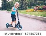 A Little Boy Is Riding A...