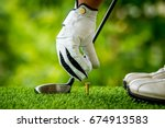Golfer Preparing Golf Ball For...