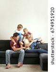 cute young family plays around... | Shutterstock . vector #674951920