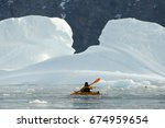 kayaking in the arctic  ... | Shutterstock . vector #674959654
