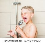 young boy singing in the shower. | Shutterstock . vector #674974420