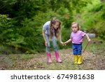 two lovely girls play in the... | Shutterstock . vector #674981638