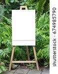 empty white board lay on in... | Shutterstock . vector #674985790