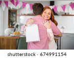 loving mother accepts a gift... | Shutterstock . vector #674991154