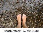 Barefoot Woman's Legs On Rocky...