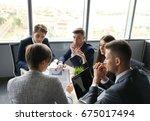 brainstorm. group of business... | Shutterstock . vector #675017494