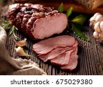 sliced smoked ham  on a wooden ... | Shutterstock . vector #675029380