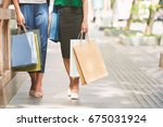 legs of women with shopping