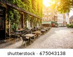 street view with cafe terrace... | Shutterstock . vector #675043138