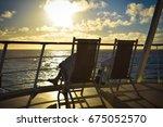two people enjoying sun in... | Shutterstock . vector #675052570