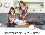 mother taking the temperature... | Shutterstock . vector #675060964