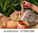 mud facial mask of woman in spa ... | Shutterstock . vector #675065188
