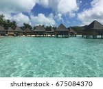 overwater bungalow on luxury... | Shutterstock . vector #675084370