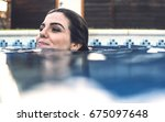 young pretty woman swimming in... | Shutterstock . vector #675097648