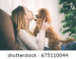 young girl is resting with a... | Shutterstock . vector #675110044