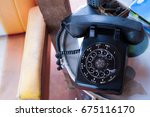 vintage black telephone | Shutterstock . vector #675116170