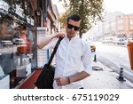 businessman with a bag  pretty... | Shutterstock . vector #675119029
