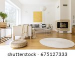 Stock photo spacious white and wooden living room with modern fireplace and sofa 675127333