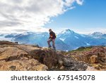 hiking man in canadian... | Shutterstock . vector #675145078