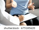 woman doctor talking to her... | Shutterstock . vector #675185620