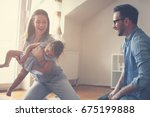 happy family sitting on floor... | Shutterstock . vector #675199888