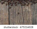 coffee beans on grunge vintage... | Shutterstock . vector #675216028