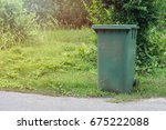 green recycling bins in the... | Shutterstock . vector #675222088