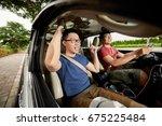 joyful vietnamese man with... | Shutterstock . vector #675225484