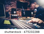 music producer working on sound ... | Shutterstock . vector #675232288