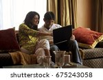 couple with a laptop   | Shutterstock . vector #675243058