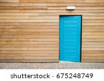 a blue door on wood wall | Shutterstock . vector #675248749