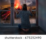 the girl looks out the window... | Shutterstock . vector #675252490