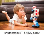 little boy playing with robot... | Shutterstock . vector #675275380