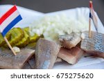 Stock photo broodje haring a traditional dutch snack seafood sandwich with herring onions and pickled 675275620