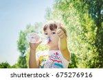 baby drinks water from bottle. | Shutterstock . vector #675276916