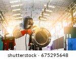 industrial worker at welding in ... | Shutterstock . vector #675295648