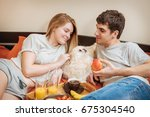 young couple is lying in bed... | Shutterstock . vector #675304540