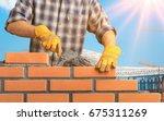 bricklayer. | Shutterstock . vector #675311269