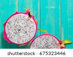 healthy dragon fruits on wooden ...   Shutterstock . vector #675323446