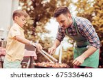 father and son having a... | Shutterstock . vector #675336463
